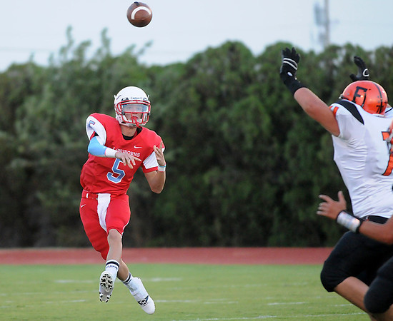 Chisholm's Tabor Charles throws a pass against Fairview Friday at Chisholm High School. (Staff Photo by BILLY HEFTON)