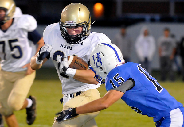 Hennessey's Steven Lott closes in on Landon Nault of Kingfisher during the first half Friday at Hennessey High School. (Staff Photo by BILLY HEFTON)