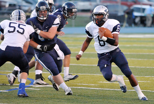 Chance Pryor scrambles for yardage against Bartlesville Friday at Bartlesville High School. (Staff Photo by BILLY HEFTON)