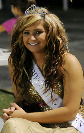 Pioneer homecoming queen Sonni Gainer sits on the sidelines as homecoming king Nick Denker plays in Friday's game against Snyder. (Staff Photo by BONNIE VCULEK)