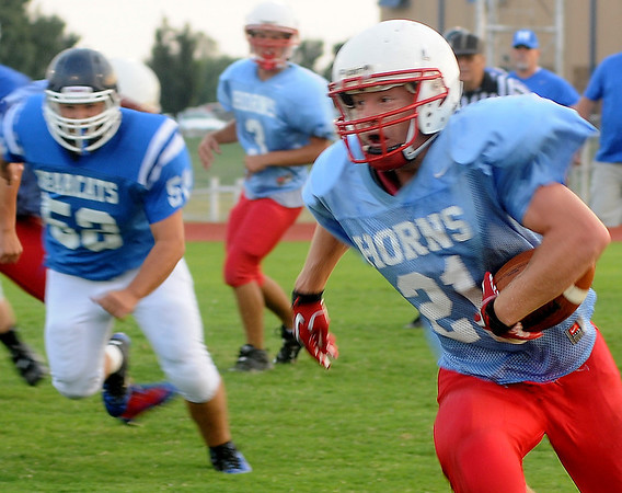 Chisholm's Brock Chance sprints for a long gain Thursday against the Mooreland Bearcats at Chisholm High School. (Staff Photo by BONNIE VCULEK)