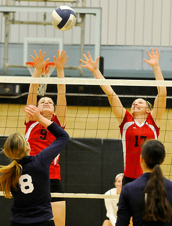 OBA's Brooke Wayman and Hannah Jackson stretch the ball Monday at Waller Middle School. (Staff Photo by BILLY HEFTON)