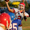 Kremlin-Hillsdale quarterback, Trev Schoenhals, throws a pass against Waukomis Friday at Waukomis HIgh School during the opening game of the season. (Staff Photo by BILLY HEFTON)
