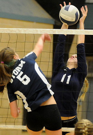 Shaelyn Vaughn stretches to block a shot against the OKC Storm Monday at Waller Middle School. (Staff Photo by BILLY HEFTON)