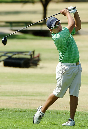 Hayden Betchan hits his tee shot on the first hole Monday at Oakwood Country Club during the Enid City Junior Golf Championship. (Staff Photo by BILLY HEFTON)