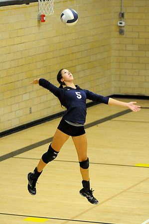 Mariah Wagner serves against the OKC Storm Monday at Waller Middle School. (Staff Photo by BILLY HEFTON)