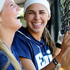 Haven Bay and Courtney Chelf (from left) celebrate Chelf's record-breaking, eleventh home run of the season Thursday after the blast over the center field wall scored Bay and Chelf in the bottom of the first inning against the Stillwater Lady Pioneers at Pacer Field. (Staff Photo by BONNIE VCULEK)