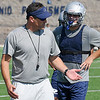 Enid High football coach, Steve Chard, coaches players at D. Bruce Selby Stadium Tuesday on the first day of official practice for high school teams across the state. (Staff Photo by BILLY HEFTON)