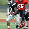 OBA's Chris Walker finds some running room against Crossing Christian Thursday during the last scrimmage before the start of the season next week. (Staff Photo by BILLY HEFTON)