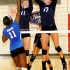 Enid Pacers' Shaelyn Vaughn and Grace Enmeier block a shot by Moore Lady Lions' Aria Lewis Tuesday during the Pacers' volleyball victory at the Mabee Center. (Staff Photo by BONNIE VCULEK)