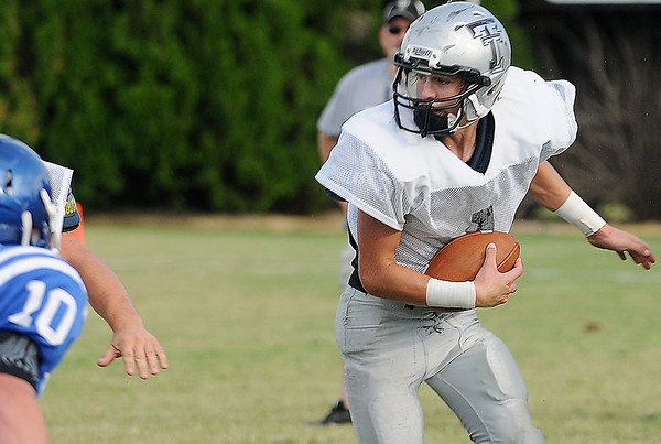 Timberlake's Braden Seaman looks for an opening as he runs against Covington-Douglas Friday during a scrimmage in Jet. (Staff Photo by BILLY HEFTON)