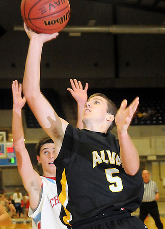 Alva's Trevor Johnson scores as Chisholm's Danner Kiernan defends during the Goldbugs' 65-56 win over the Longhorns in the OBA Prep Classic at the Chisholm Trail Expo Center Coliseum. Alva advances to the finals and Chisholm will play for third Saturday. (Staff Photo by BONNIE VCULEK)