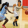 Enid's Courtney Chelf looks for an opening against Lawton Ike's Sydney Ellis Friday at the NOC-Enid Mabee Center. (Staff Photo by BILLY HEFTON)
