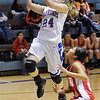 Sadie Perry of Waukomis jumps pass Dover's Tracy Rios Tuesday at Waukomis High School. Waukomis defeated the Lady Longhorns 76-41. (Staff Photo by BILLY HEFTON)
