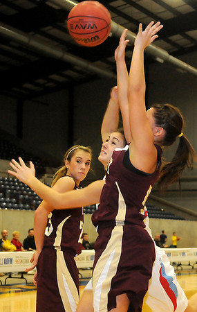 A shot by Chisholm's Kammi Gruber is blocked by Ripley's Wisper Lefthand during the OBA Prep Classic Saturday at the Chisholm Trail Coliseum. (Staff Photo by BONNIE VCULEK)
