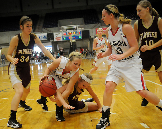 OBA's Anna Zander and Pioneer's Lexsie Mann (center) battle for the ball during the OBA Prep Classic Friday afternoon at the Chisholm Trail Expo Center Coliseum. (Staff Photo by BONNIE VCULEK)