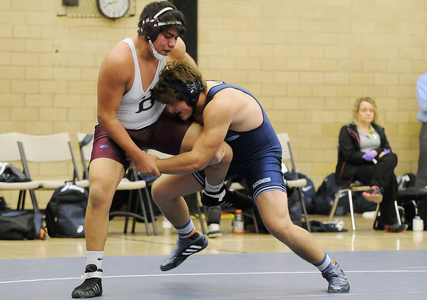 Jake Scott gains control of the leg of Blackwell's Carlos Callega on his way to a pin in their 220 match Tuesday at Waller Middle School. (Staff Photo by BILLY HEFTON)