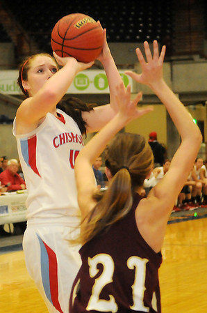 Chisholm's Morgan Lawver pulls up for a shot against Ripley's Jaclyn Sturgeon Saturday during the OBA Prep Classic at the Chisholm Trail Coliseum. (Staff Photo by BONNIE VCULEK)