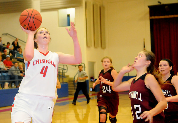 Chisholm's Morgan Lawver scores for the Lady Longhorns Tuesday during a game against the Blackwell Lady Maroons in the Paul J. Outhier Fieldhouse. (Staff Photo by BONNIE VCULEK)