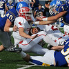 Ringling's Dustin Eubanks (40), Drue McElroy (32) and Ronnie Ward tackle Texhoma quarterback, Jack Powers, Saturday during the Blue Devils' 35-21 win in the OSSAA Class A state football semi-finals at D. Bruce Selby Stadium in Enid, Okla. (Photo Courtesy of ENID NEWS and EAGLE, BONNIE VCULEK)