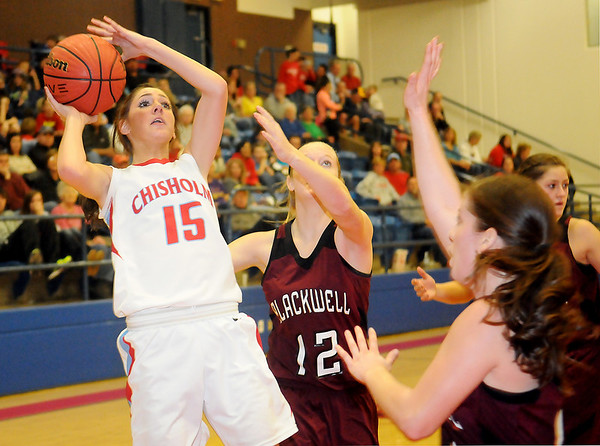 Chisholm's Faith Mirelez (left) shoots a short jumper over the arms of three Blackwell Lady Maroons Tuesday at the Paul J. Outhier Fieldhouse. Chisholm won 60-40. (Staff Photo by BONNIE VCULEK)