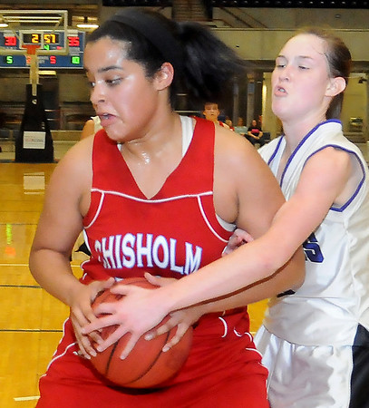 Chsisholm's Emily Raynor controls the ball under the bucket against a Wichita Lady Warrior Thursday during the Lady Longhorns 37-36 win in the OBA Prep Classic at the Chisholm Trail Expo Center Coliseum. (Staff Photo by BONNIE VCULEK)
