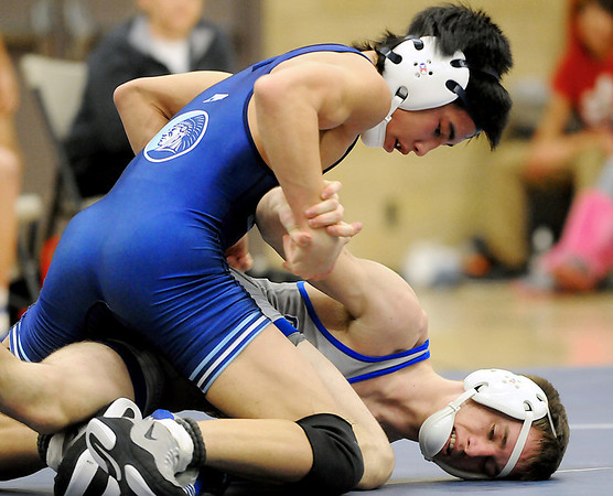 Enid's Billy Grothe maintains control of Sapulpa's Jake Wallace enroute to a 4-2 win at 126 pounds Thursday at Waller Middle School. (Staff Photo by BILLY HEFTON)