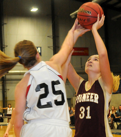 Pioneer's Lexsie Mann (right) takes a shot as OBA's Kate Anderson defends Friday during the OBA Prep Classic at the Chisholm Trail Expo Center Coliseum. (Staff Photo by BONNIE VCULEK)