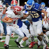 Ringling's Drue McElroy tackles Texhoma's Jack Powers behind the line Saturday during the Ringling Blue Devils' 35-21 win over the Texhoma Red Devils in the OSSAA Class A State football semi-finals at D. Bruce Selby Stadium in Enid. (Staff Photo by BONNIE VCULEK)