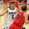 Enid's Haven Bay pressures Lawton's Sydnie Puziak Saturday at the NOC-Enid Mabee Center. (Staff Photo by BILLY HEFTON)