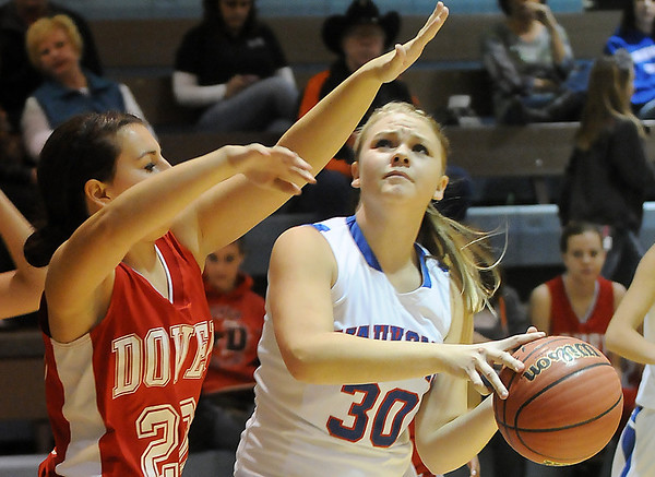 Alexa of Waukomis looks for a shot while being defended by Dover's Alex Beck Tuesday at Waukomis High School. Waukomis defeated the Lady Longhorns 76-41. (Staff Photo by BILLY HEFTON)