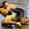 Zac Overbeck controls a Woodward wrestler in a 220-pound match during the Mid-America National Wrestling Championships at the Enid Event Center Saturday, Dec. 14, 2013. (Staff Photo by BONNIE VCULEK)