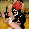 Alva's Jaden Hobbs drives the lane for two against Chisholm's Megan Galusha as the Lady Goldbugs lead 29-13 during the 11th annual OBA Prep Classic at the Chisholm Trail Expo Center Friday, Dec. 12, 2013. (Staff Photo by BONNIE VCULEK)