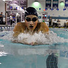Enid's Sara Nazari swims the breast stroke leg of the 200 yard IM Monday at the Denny Price Family YMCA. (Staff Photo by BILLY HEFTON)