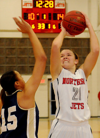 NOC Lady Jets' Rylie Swanson hits from the top of the key as Independence Pirates' Sabrina Berry defends at the Mabee Center Saturday, Dec. 7, 2013. (Staff Photo by BONNIE VCULEK)