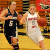 NOC-Enid Lady Jets' Kori Barrios drives around Independence Women Pirates' Kelsey Larson at the Mabee Center Saturday, Dec. 7, 2013. (Staff Photo by BONNIE VCULEK)