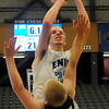Enid's Michael Majors pulls up for two as Elk City's Shayne Thornton fouls Majors, sending him to the line for the And 1 during the Plainsmen's inaugural basketball game at the Enid Event Center Friday, Dec. 6, 2013. (Staff Photo by BONNIE VCULEK)