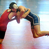 Enid's Austin Loza wrestles an opponent during a 120 pound match at the Mid-America Nationals Wrestling Championships at the Enid Event Center Friday, Dec. 13, 2013. (Staff Photo by BONNIE VCULEK)