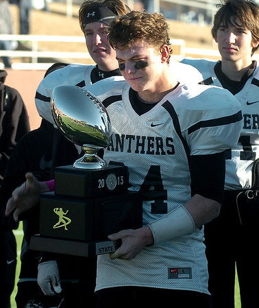 Pond Creek-Hunter's Trenton Grimes holds the runner-up trophy following the Panthers 42-12 loss to Laverne in the Class B state championship game Saturday at Southwestern Oklahoma State University in Weatherford. (Staff Photo by BILLY HEFTON)
