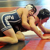 Enid's Austin Loza controls his opponent in his 6-3 win at 120 pounds during the Mid-America Nationals Wrestling Championships at the Enid Event Center Friday, Dec. 13, 2013. (Staff Photo by BONNIE VCULEK)
