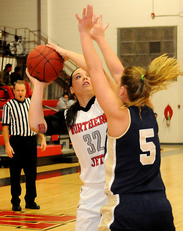 NOC Lady Jets' Kori Fast battles Independence Women Pirates' Kelsey Larson for position before Fast scores two for the Lady Jets at the Mabee Center Saturday, Dec. 7, 2013. (Staff Photo by BONNIE VCULEK)