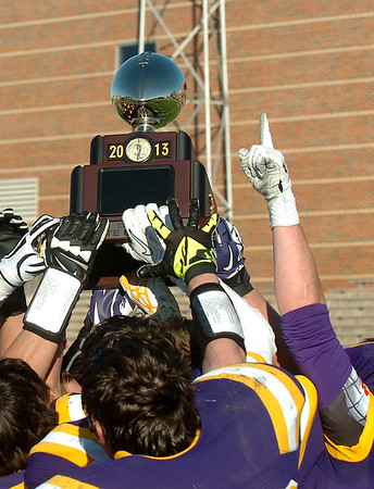 Members of the Laverne Tigers hold up the state championship trophy after defeating Pond Creek-Hunter 42-12 in the Class B championship game Saturday at Southwestern Oklahoma State University in Weatherford. (Staff Photo by BILLY HEFTON)