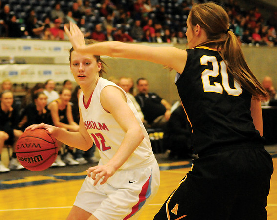 Chisholm's Kaylee Petersen dribbles inside against Alva's Jordan Shiever during the OBA Prep Classic finals at the Chisholm Trail Expo Center Saturday, Dec. 13, 2014. (Staff Photo by BONNIE VCULEK)