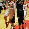 Chisholm's Kammi Gruber drives to the basket against Alva's Jordan Shiever Tuesday December 8, 2015 at Chisholm High School. (Billy Hefton / Enid News & Eagle)