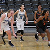 Enid's Sarah Johnson, Zurae Willson, Ashley Handing and Putnam City's Tamera Burdex and Jayla Jones all have different reactions at the end of Enid's 64-63 win over Putnam City Tuesday December 13, 2016 ay the Central National Bank Center. (Billy Hefton / Enid News & Eagle)