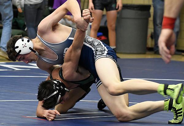 Enid's Tyler Reese takes down Edmond Santa Fe's Tyler Robert in their 138 pound match Thursday December 1, 2016 at Waller Middle School. (Billy Hefton / Enid News & Eagle)