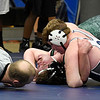 Enid's Brian Pemberton pins James King of Edmond Santa Fe in their 220 pound match Thursday December 1, 2016 at Waller Middle School. (Billy Hefton / Enid News & Eagle)