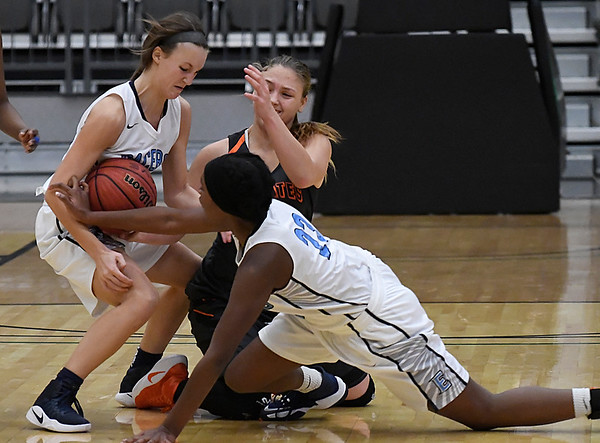 Enid's Emily Angleton and Cayti Moeller take the ball away from Putnam City's Kelzie Orr Tuesday December 13, 2016 ay the Central National Bank Center. (Billy Hefton / Enid News & Eagle)