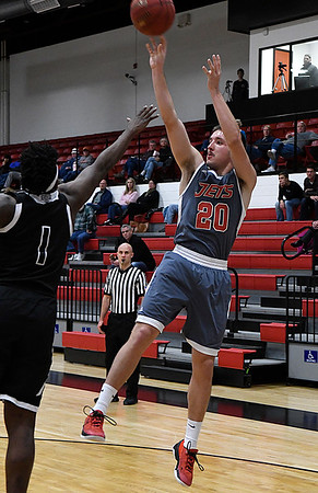 NOC Enid's Ty Lazenby shoots over Sunrise Academy's Bryan Trimble Thursday December 8, 2016 at the NOC Mabee Center. (Billy Hefton / Enid News & Eagle)