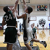 OBA's William Price gets a shot over Tabor Mannering of Thomas Friday December 16, 2016 at Oklahoma Bible Academy. (Billy Hefton / Enid News & Eagle)